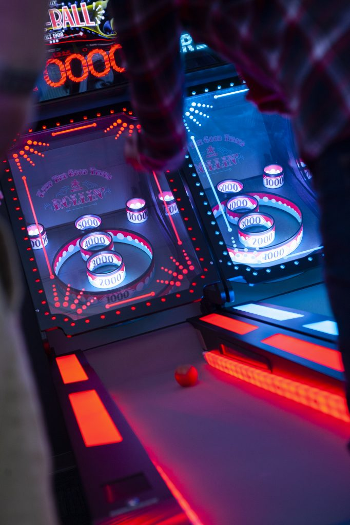 People Playing Skee-Ball